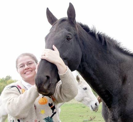 Michelle Kutzler, a veterinary clinician, with Ski Run Lady, a thoroughbred mare donated to the college for its equine reproduction program