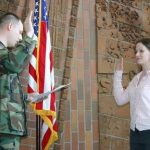 Army 1st Lt. Lance McIntire gives the oath of office to Oregon State veterinary student Rhonda Reaves.