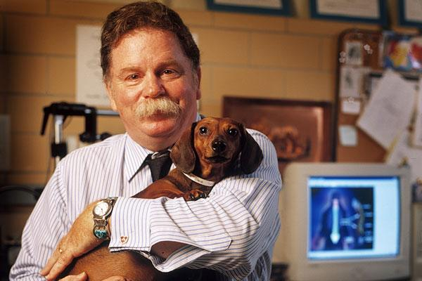 Richard Borgens, director of Purdue's Center for Paralysis Research, helps paralyzed dogs, like Kady, walk again with the help of treatments like polyethylene glycol injections.