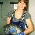 Veterinary student Tracy Sudlow holds Kayak, a harbor seal pup she rehabilitated as an intern at the Alaska SeaLife Center in Seward, Alaska.
