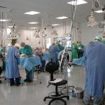 St. George's University veterinary students at work in a surgical suite.