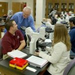 Faculty engage students both in the field as well as in the laboratory as seen here.