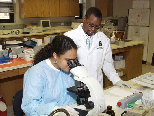 A Tuskegee veterinary student does lab research.