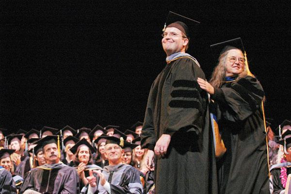 Dr. Joan Dean Rowe hoods a veterinary graduate at the 2007 commencement ceremony.