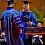 Class of 2008 Veterinary College graduates proudly wear orange and blue.