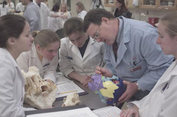 Dr. Larry Freeman instructs first-year students in anatomy.
