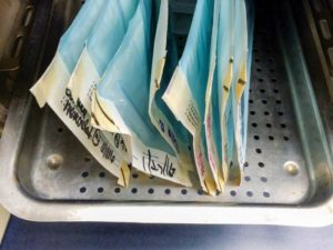 This photo illustrates the correct way to place pouches in an autoclave rack.