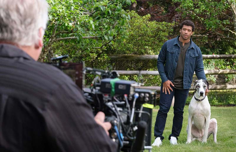 "Professional football player Russell Wilson and his dog, Naomi, are featured in Banfield Foundation's ""Safer Together"" public service announcement (PSA)."