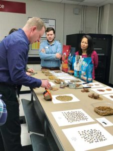 Travis Fiedler, Purina PetCare's director of quality assurance, illustrates a sensory review of a tin of wet cat food.