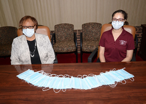 Zoetis has gifted non-sterile surgical masks to the Tuskegee University College of Veterinary Medicine. Pictured is the college's dean, Dr. Ruby L. Perry (left), and Dr. Ebony Gilbreath, who will oversee distribution of the donation.