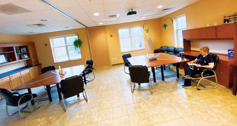 For clinics with larger teams, reduce the number of chairs at tables, spacing them six feet apart and using colored tape on table surfaces to indicate separate seating.